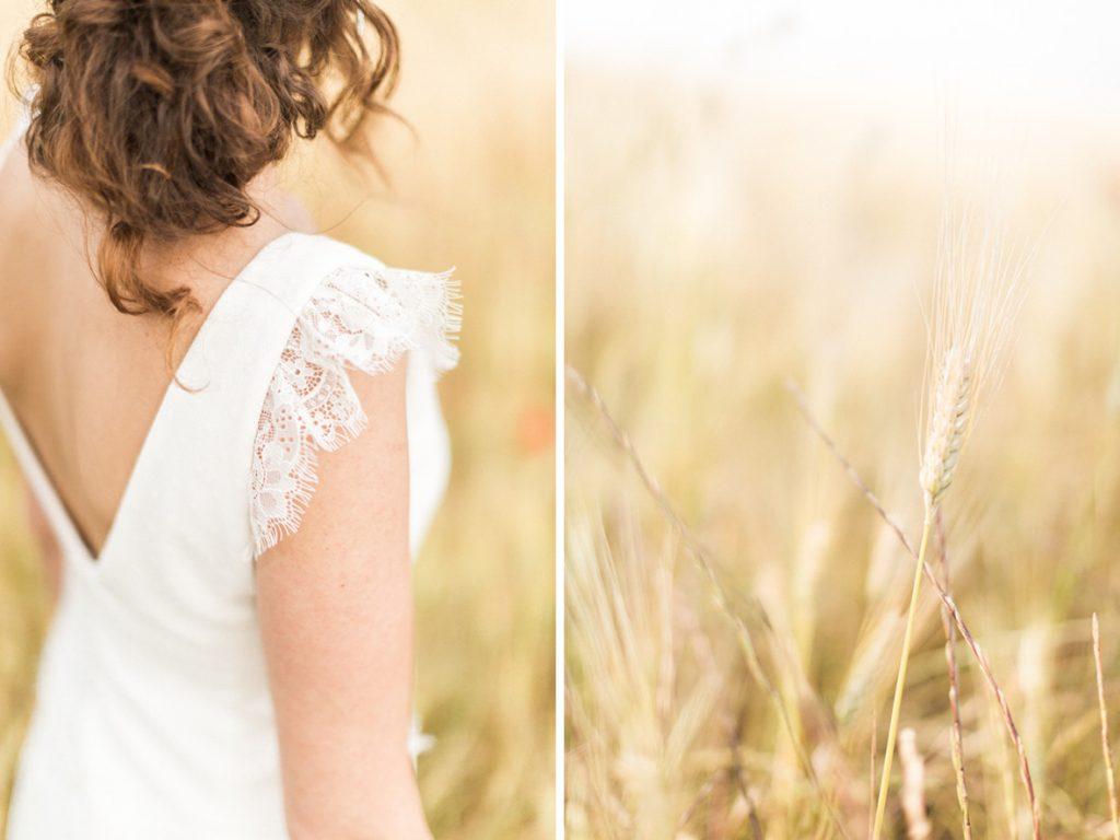 détails robe de la mariée dans un champ de blé